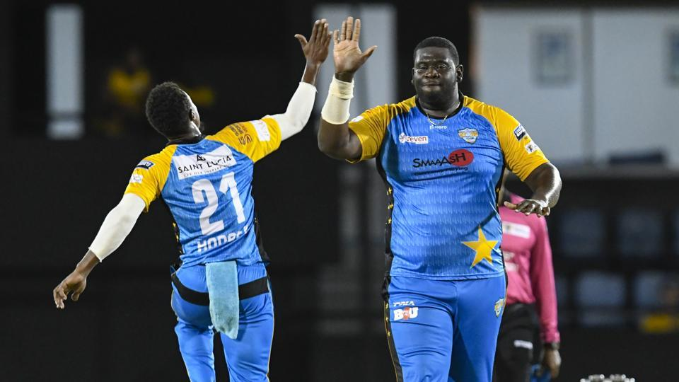 In this handout image provided by CPL T20, Kavem Hodge (L) and Rahkeem Cornwall (R) of St Lucia Stars celebrate the dismissal of Chris Lynn of Trinbago Knight Riders during match 9 of the Hero Caribbean Premier League.