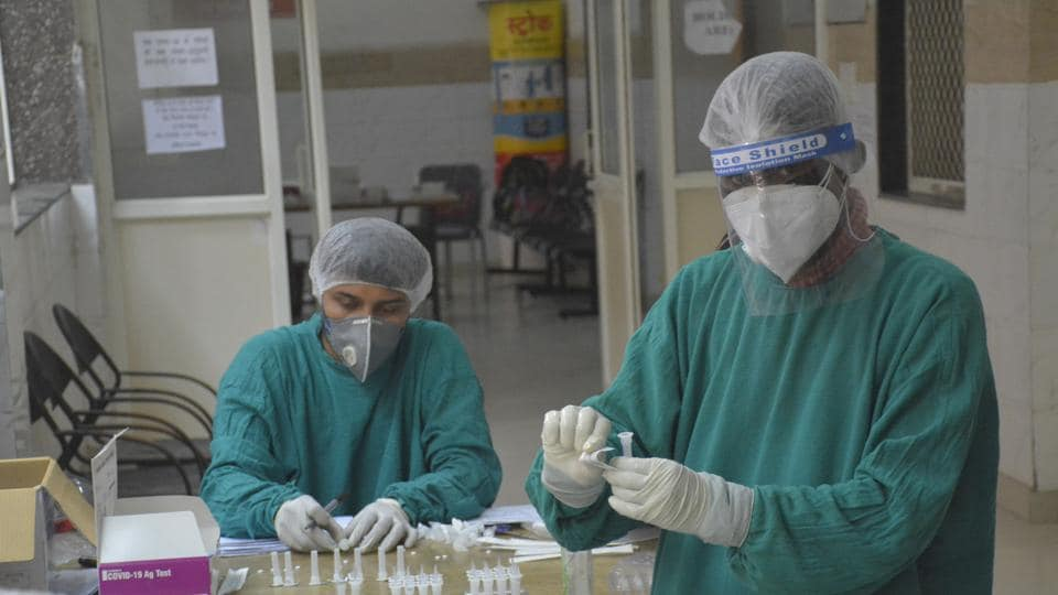 Health workers seen during coronavirus sample testing at MMG District Hospital in Ghaziabad on August 04, 2020.