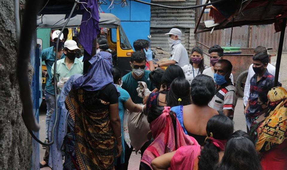 NGO workers hand over dry ration to sex workers, Pune , June 23, 2020