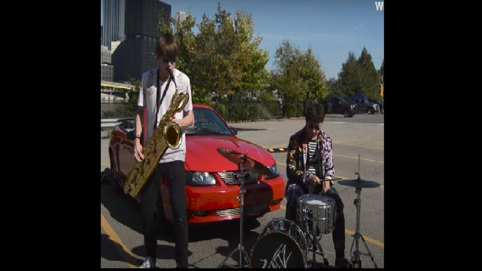 """""""Car Alarm Sax,"""" shared with this caption on Reddit, the video showcases a band named Big Blitz,"""