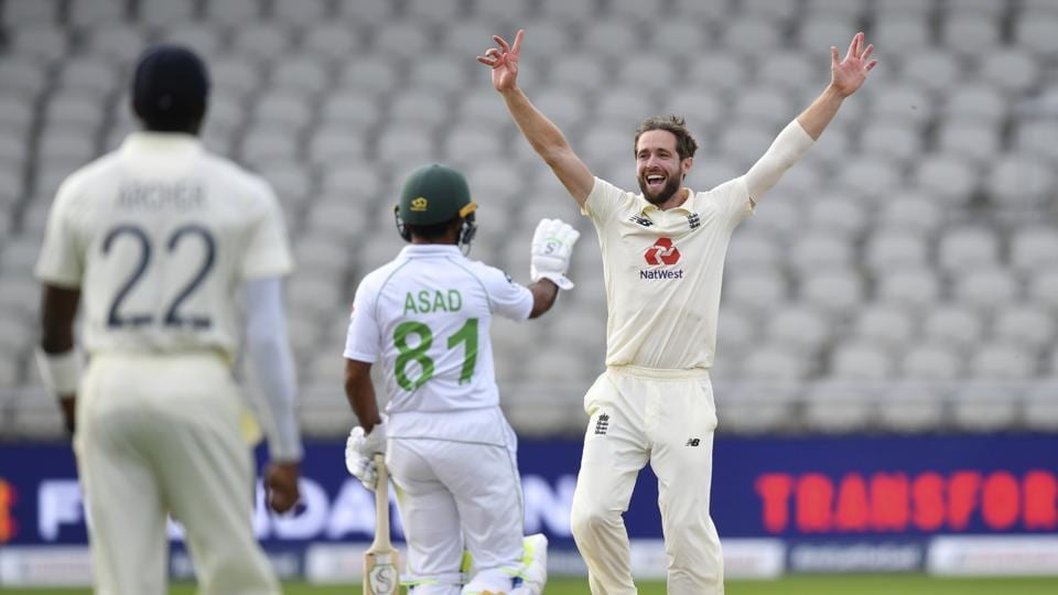 England's Chris Woakes, right, appeals successfully for the wicket of Pakistan's captain Azhar Ali.