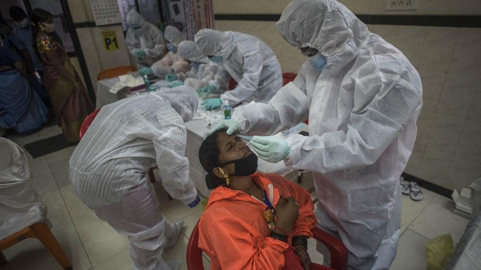 Healthworkers from Lifecare during the Rapid Covid-19 test of the BMC workers at Asha Hall, Govandi in Mumbai.