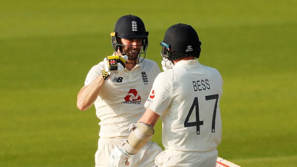 England's Chris Woakes celebrates winning the match with Dom Bess, as play resumes behind closed doors following the outbreak of the coronavirus disease