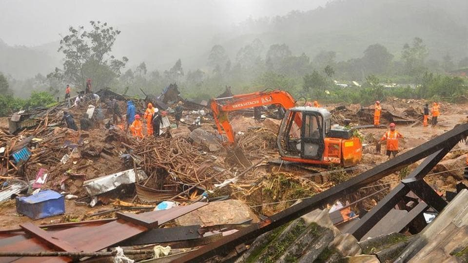 Rescue workers look for survivors at the site of a landslide during heavy rains in Idukki, Kerala on August 7, 2020.
