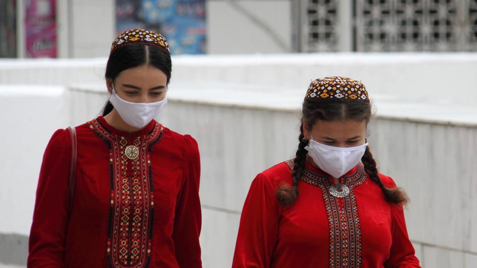 Women wearing protective face masks, used as a preventive measure against the spread of the coronavirus disease (Covid-19), walk along the street in Ashgabat, Turkmenistan.