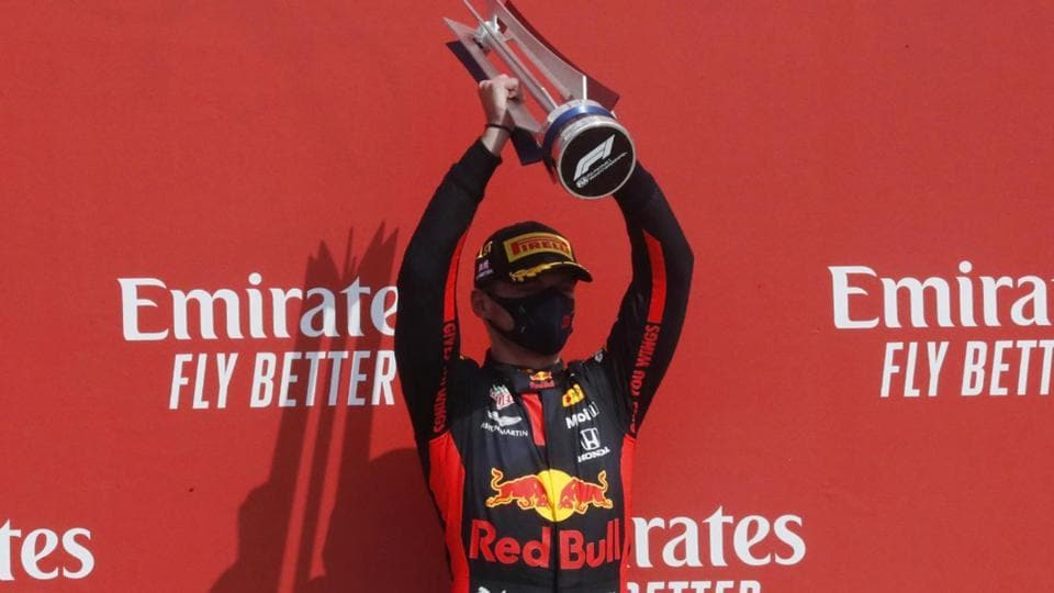 Red Bull's Max Verstappen celebrates his win on the podium after the race.