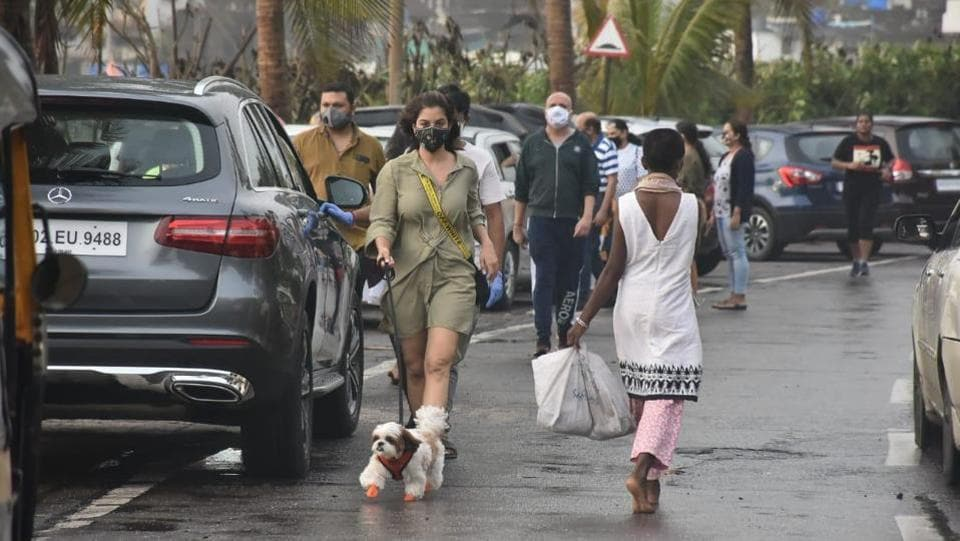 Sophie Choudry walking her dog.