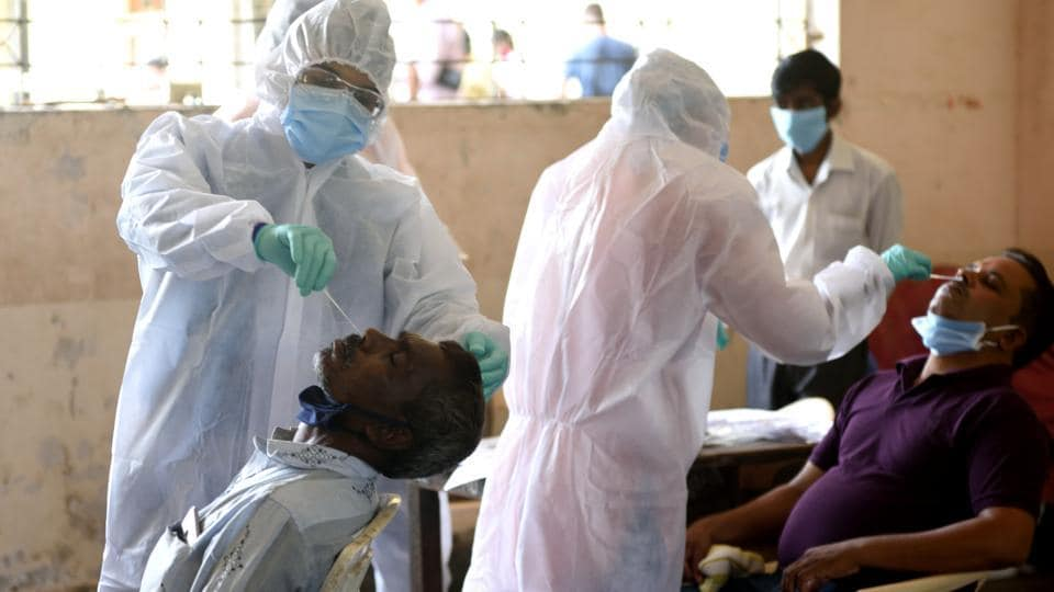 A BMC health care worker take a swab for antigen test in the Trombay during Covid-19 pandemic.