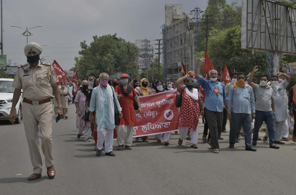 Members of labour unions,  under the banner of CITU, protesting  outside  the deputy commissioner's office in Ludhiana on Sunday.