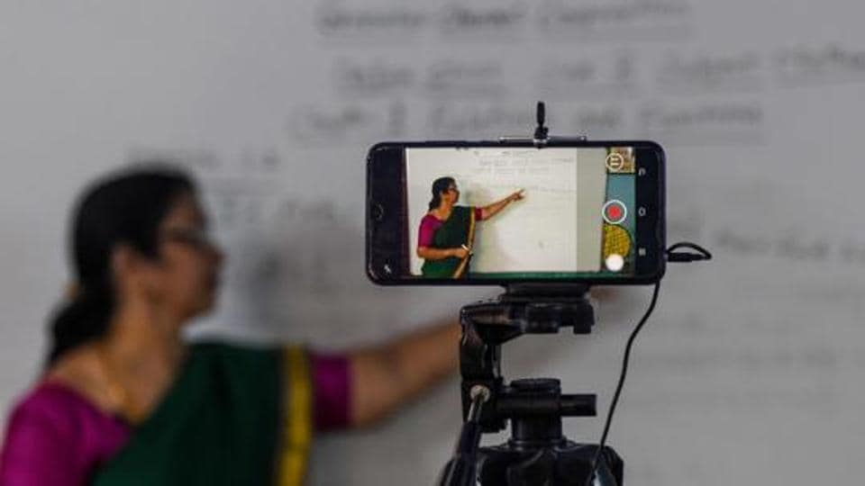 A school teacher gives a live streaming online class at a government school after the government eased a nationwide lockdown