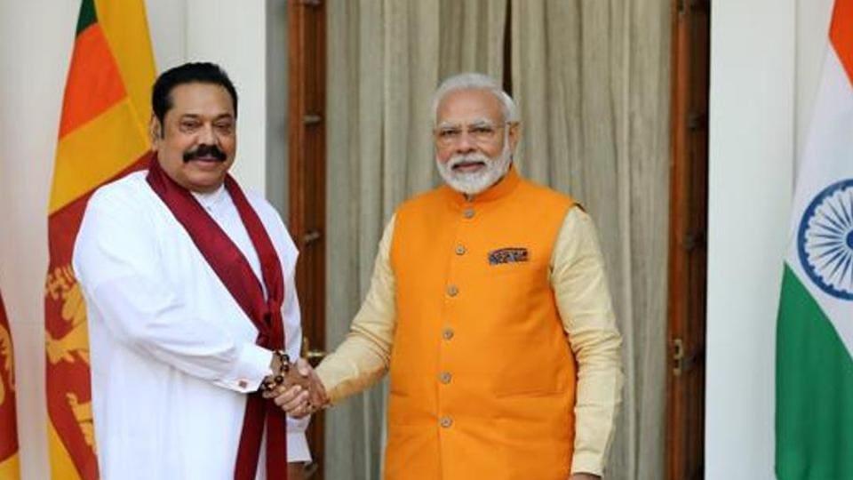 Narendra Modi, India's prime minister, right, shakes hands with Mahinda Rajapaksa, Sri Lanka's prime minister, at Hyderabad House in New Delhi.