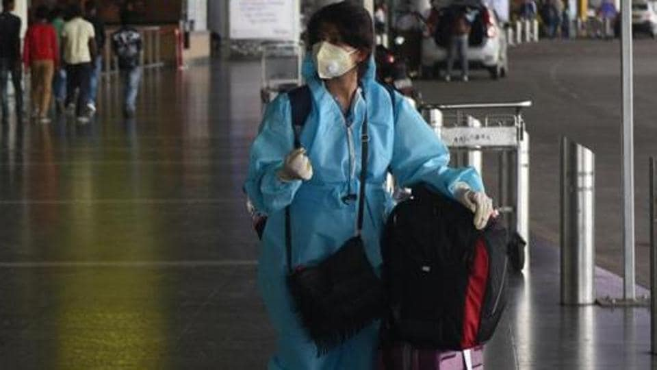 A traveller in PPE coveralls at the Netaji Subhas Chandra Bose International (NSCBI) Airport in Kolkata, West Bengal, India.