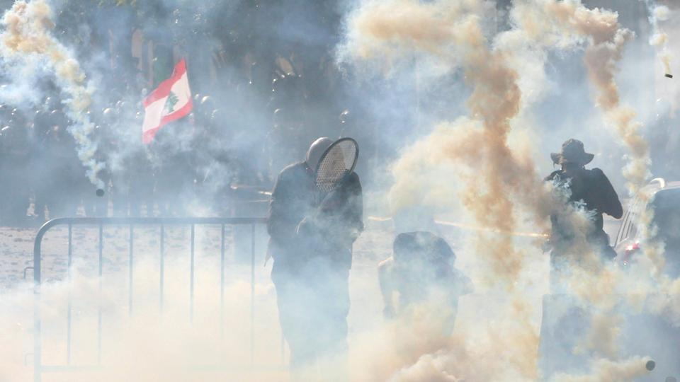 Riot police fire tear gas at demonstrators during a protest, following Tuesday's blast, in Beirut, Lebanon.