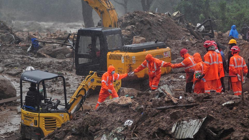 Rescue workers look for survivors at the site of a landslide during heavy rains in Idukki, Kerala, India, August 9, 2020.