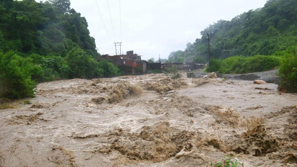 A seasonal river overflowing in Dehradun on Monday after continuous rainfall.