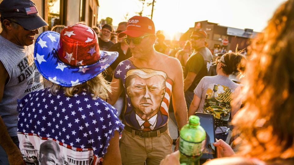 Johne Riley walks down Main Street showing off his chest painted with a portrait of President Trump during the 80th Annual Sturgis Motorcycle Rally on August 7 in Sturgis, South Dakota. Health officials meanwhile, watched with alarm at the annual 10-day motorcycle rally with fears of a superspreader event. The state has no mask mandates, and many bikers expressed defiance of measures meant to prevent contagion. (Michael Ciaglo / Getty Images / AFP)
