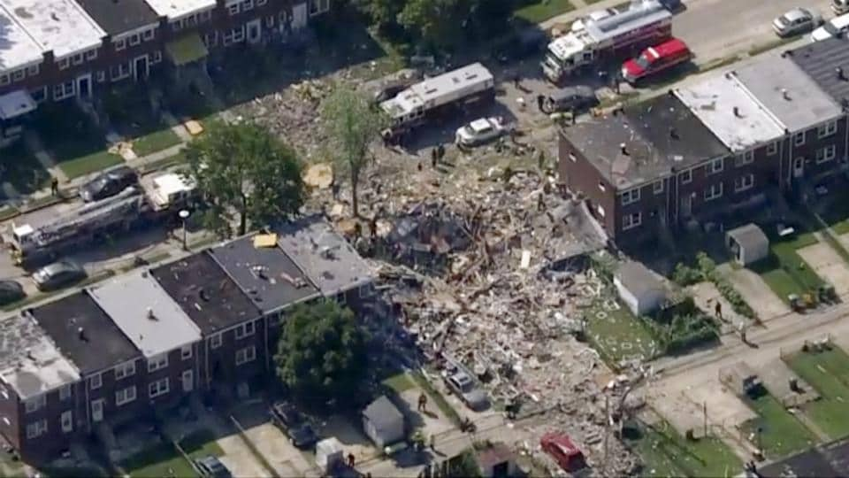 Baltimore firefighters say an explosion has leveled several homes in the city.