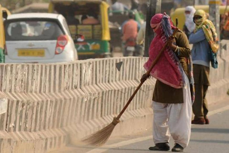 Sanitation workers are seen cleaning a road in this file photo. Odisha chief minister Naveen Patnaik has launched a scheme for sanitation workers in the state.