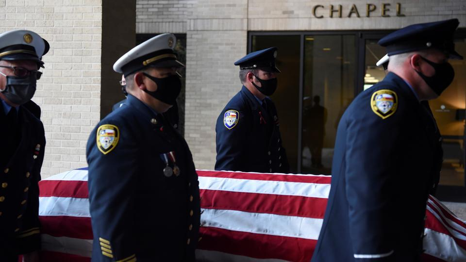 "Members of the Houston Fire Department carry the casket of a firefighter who died of Covid-19 on August 8. ""There's no national strategy, no national leadership, and there's no urging for the public to act in unison and carry out the measures together,""Dr. David Ho, director of the Aaron Diamond AIDS Research Center at Columbia University Irving Medical Center told AP. ""That's what it takes, and we have completely abandoned that as a nation."" (Callaghan O'Hare / REUTERS)"