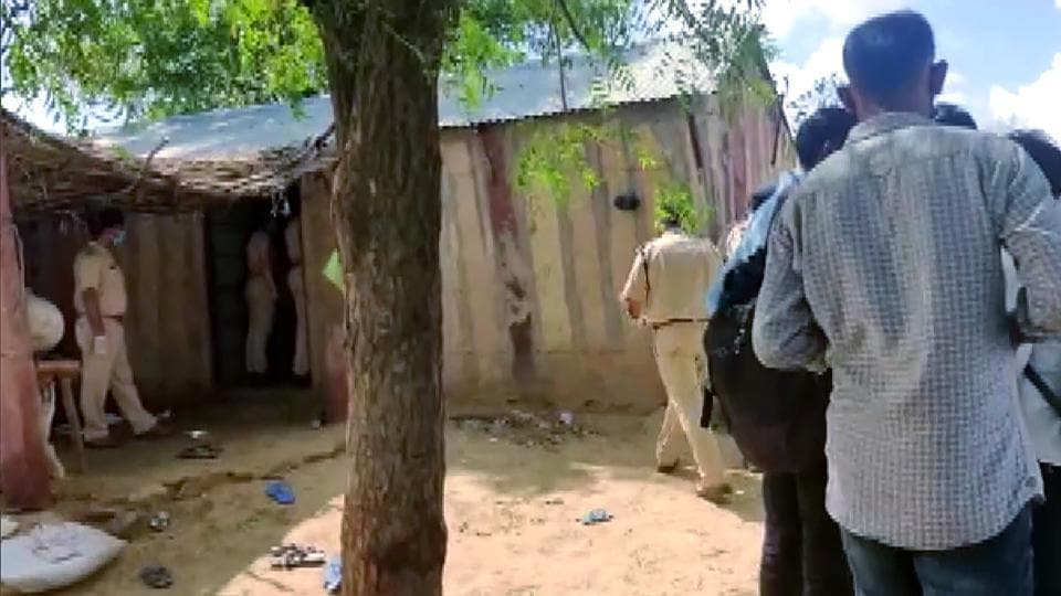 Police personnel at the spot where 11 members of a family that had migrated from Pakistan, were found dead at their home in Lodata village of Jodhpur district on Sunday.