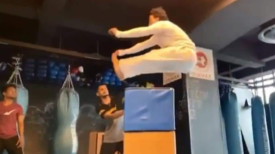 Tiger Shroff performs a high jump.