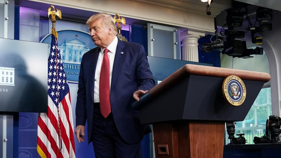 US President Donald Trump leaves after a coronavirus disease pandemic briefing at the White House.