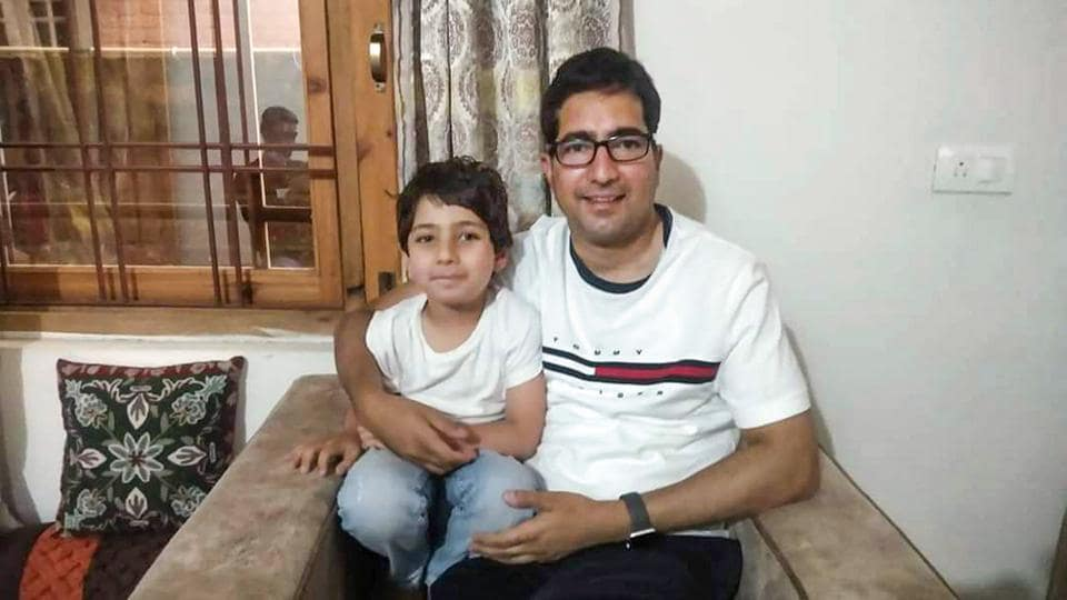 Former IAS topper turned politician Shah Faesal with his family members at his residence, in Srinagar.