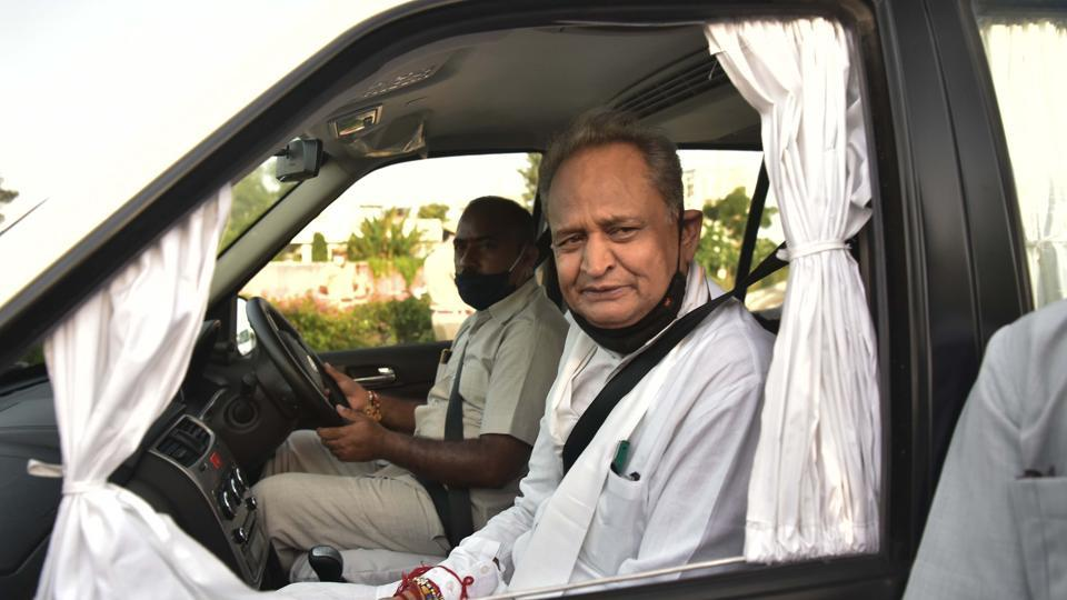 Chief Minister Ashok Gehlot interacts with media persons outside state hangar after his arrival from Jaisalmer, in Jaipur.