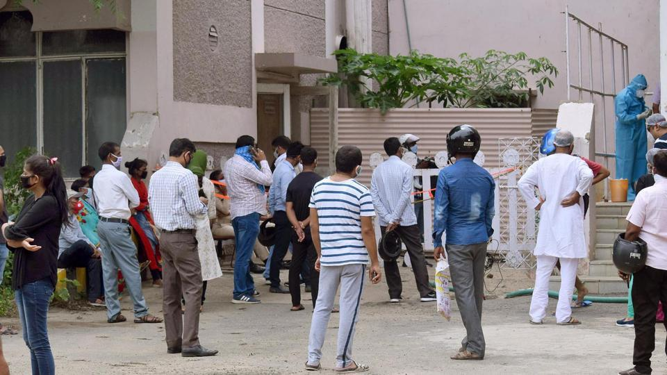 People wait to give swab samples for coronavirus testing at a collection centre in Hotel Pataliputra Ashoka, in Patna.
