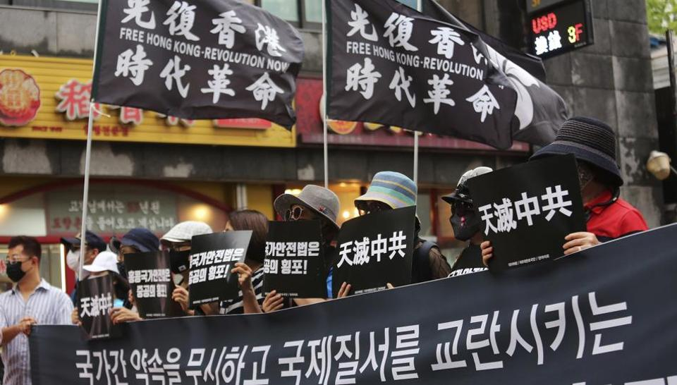 Protesters denounce the arrest of Hong Kong media tycoon Jimmy Lai during a rally against the National Security Law imposed in Hong Kong near the Chinese Embassy in Seoul, South Korea, Tuesday, Aug. 11, 2020.