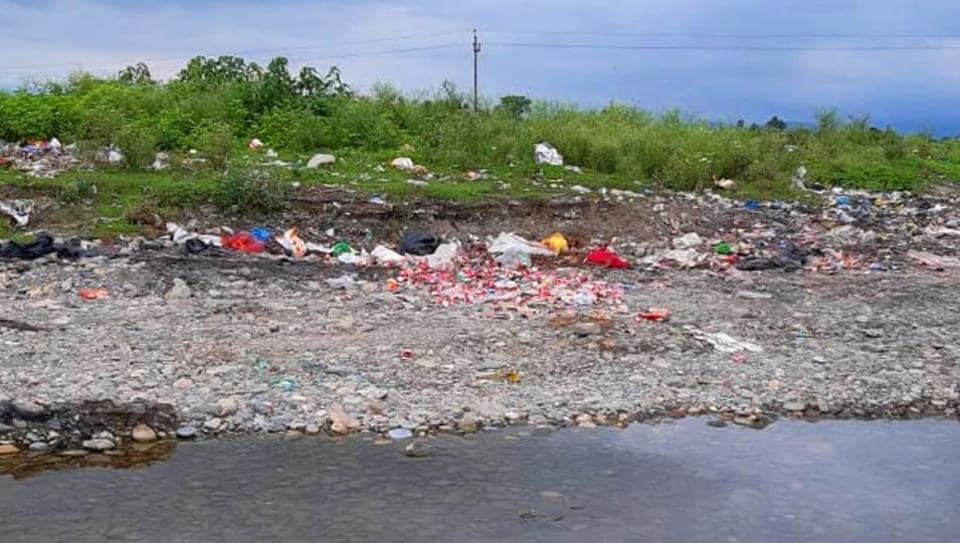 Solid waste dumped near a river bank in Dehradun.