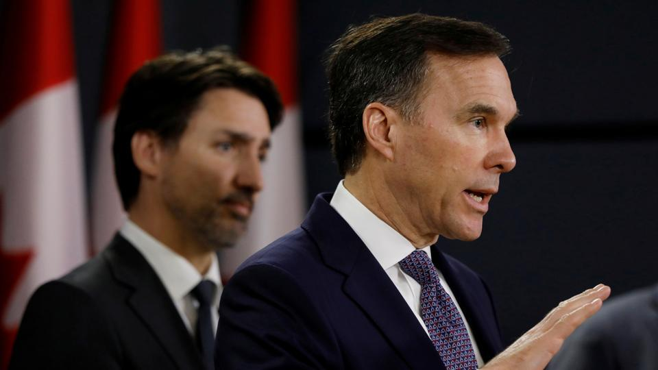 Canada's Minister of Finance Bill Morneau attends a news conference with Prime Minister Justin Trudeau in Ottawa, Ontario.