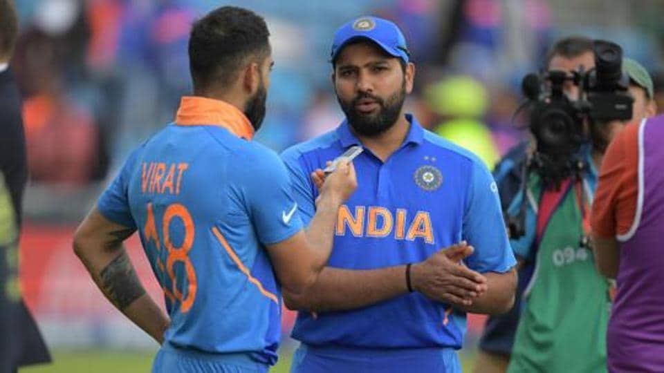 India's Rohit Sharma (C) is interviewed by India's captain Virat Kohli (L)
