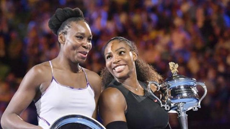 Serena Williams (R) and Venus Williams of the United States attend an award ceremony following their Australian Open women's singles final in Melbourne on Jan. 28, 2017