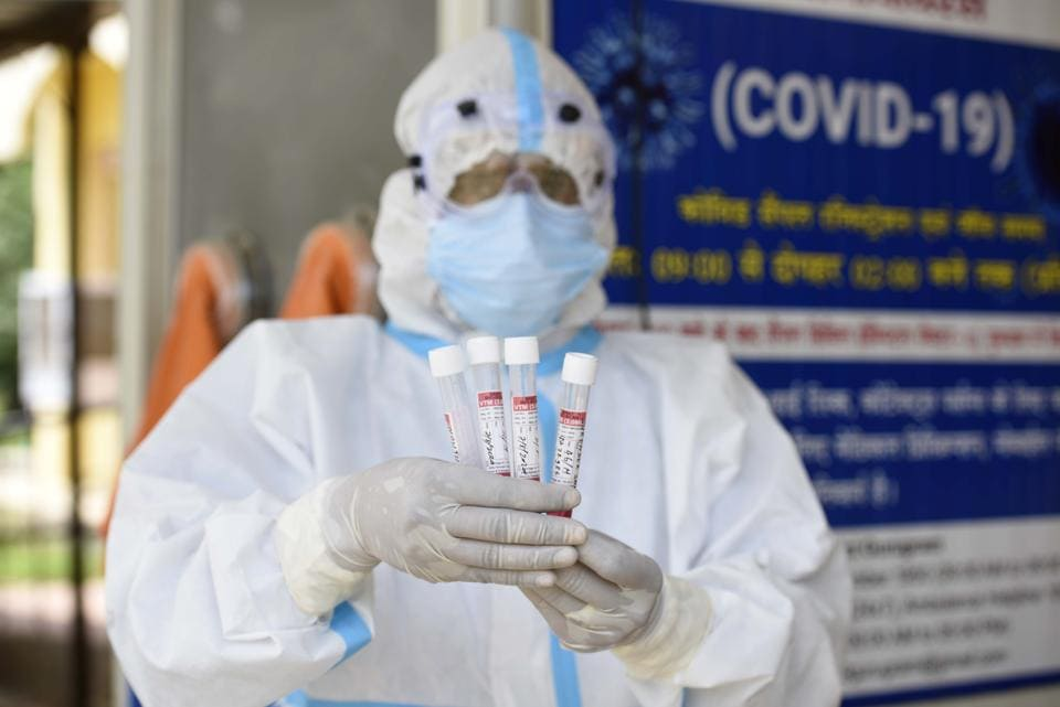 A health worker shows the collected swab sample for Reverse transcription-polymerase chain reaction (RT-PCR) for coronavirus test at the Ayushman Bharat Health and Wellness Centre in Gurugram.  India's Covid-19 tally went beyond  2.32 million after more than 60,000 cases of the coronavirus disease and over 834 deaths in the last 24 hours.