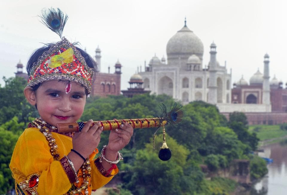 Agra: A child dressed as Lord Krishna poses for a photograph in the backdrop of Taj Mahal, on the occasion of Krishna Janmashtami festival, in Agra, Wednesday, Aug 12, 2020.  (PTI)