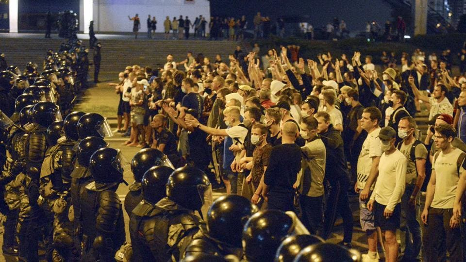 People argue with the police during a rally after the Belarusian presidential election in Minsk, Belarus on August 9. Thousands of protesters rose in anger in the capital Minsk after a state exit poll showed long-time leader Alexander Lukashenko looked set to declare a sweeping victory by 80% in a presidential poll, AP reported. (AP / PTI)