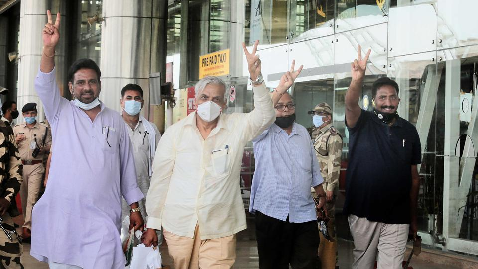 Congress MLAs show the victory sign upon their arrival at Jaipur International Airport in Jaipur  on Wednesday.