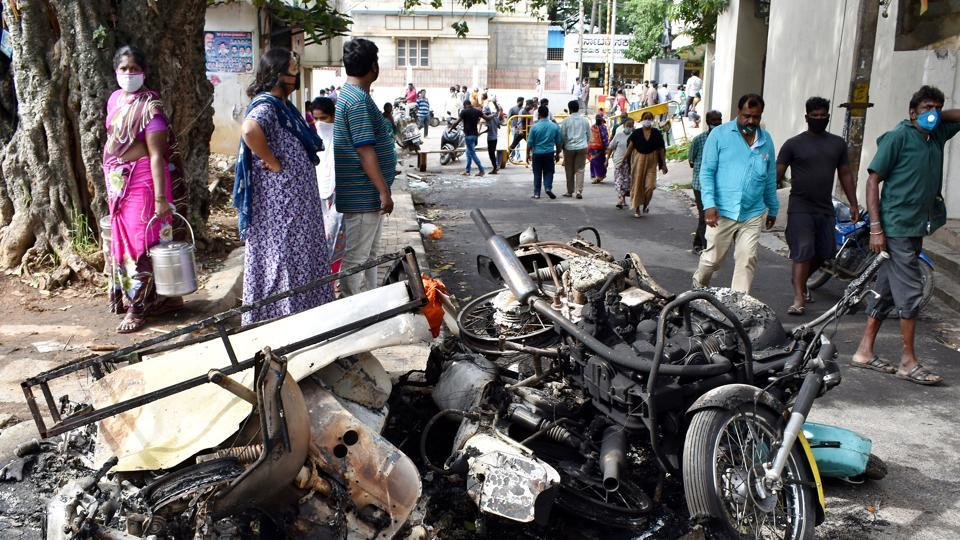 Vehicles burnt by angry mob following an alleged remark on Prophet Mohammad.