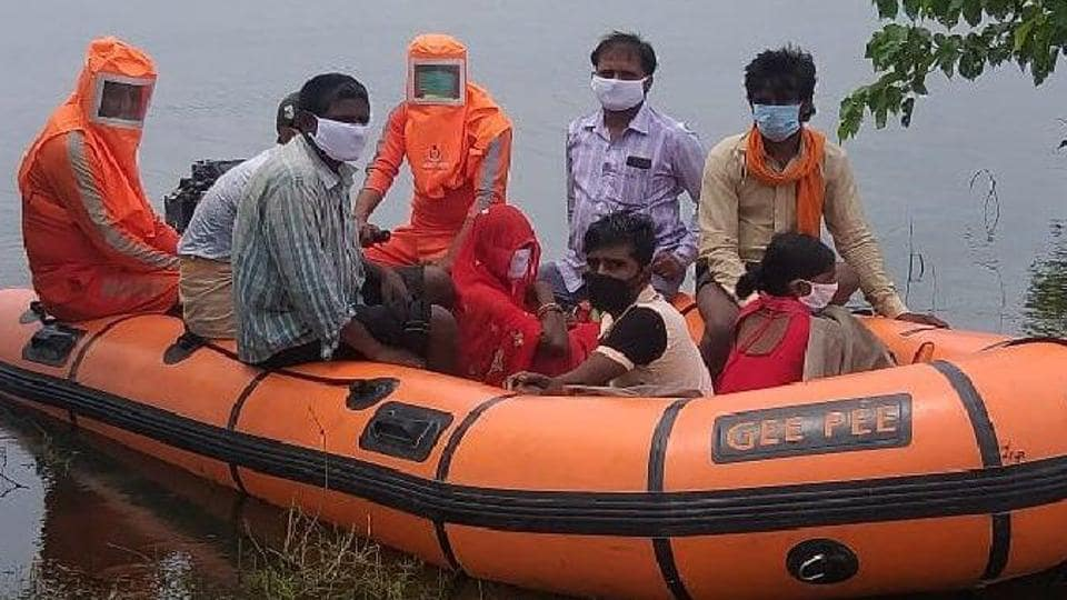 NDRF personnel rescuing people from flood-affected Darbhanga in Bihar on Wednesday.