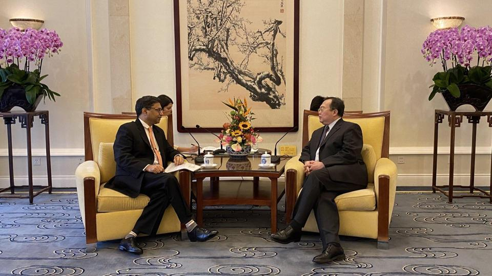 Indian Ambassador to China, Vikram Misri with Liu Jianchao, Deputy Director of the Office of the Communist Party of China Central Committee Foreign Affairs Commission in a meeting.