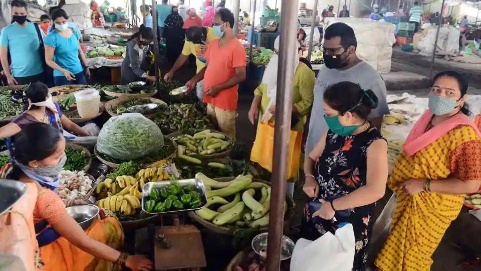 People buy vegetables from Wadgaonsheri vegetable market ahead of lockdown in Pune