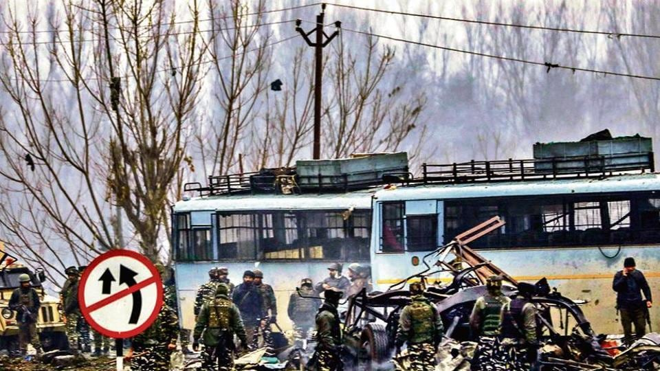 Security personnel carry out rescue and relief work at the site of a suicide bomb attack at Lathepora Awantipora in Pulwama district of south Kashmir on February 14, 2019.