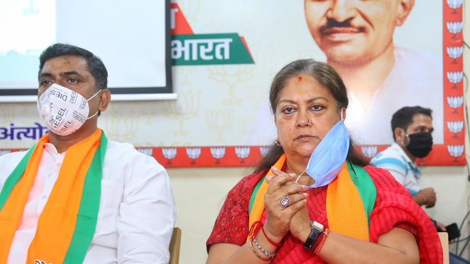Former Rajasthan chief minister Vasundhara Raje with senior BJP leader Murlidhar Rao during a meeting of party MLAs, at BJP office in Jaipur on Thursday.