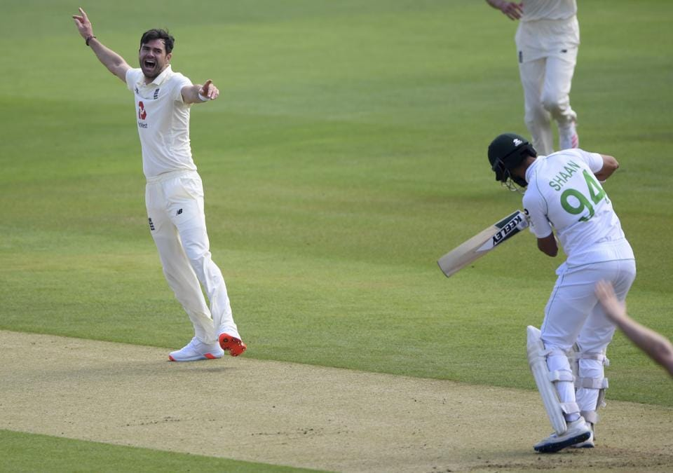 England's James Anderson, left, celebrates the dismissal of Pakistan's Shan Masood, right, during the first day of the second cricket Test match between England and Pakistan, at the Ageas Bowl in Southampton, England, Thursday, Aug. 13, 2020. (Stu Forster/Pool via AP) (AP)