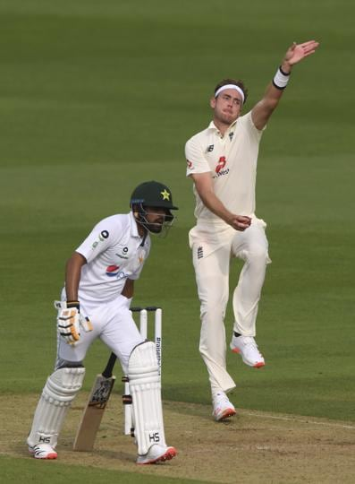 England's Stuart Broad, right, bowls a delivery past Pakistan's Babar Azam during the first day of the second cricket Test match between England and Pakistan, at the Ageas Bowl in Southampton, England, Thursday, Aug. 13, 2020. (Stu Forster/Pool via AP) (AP)