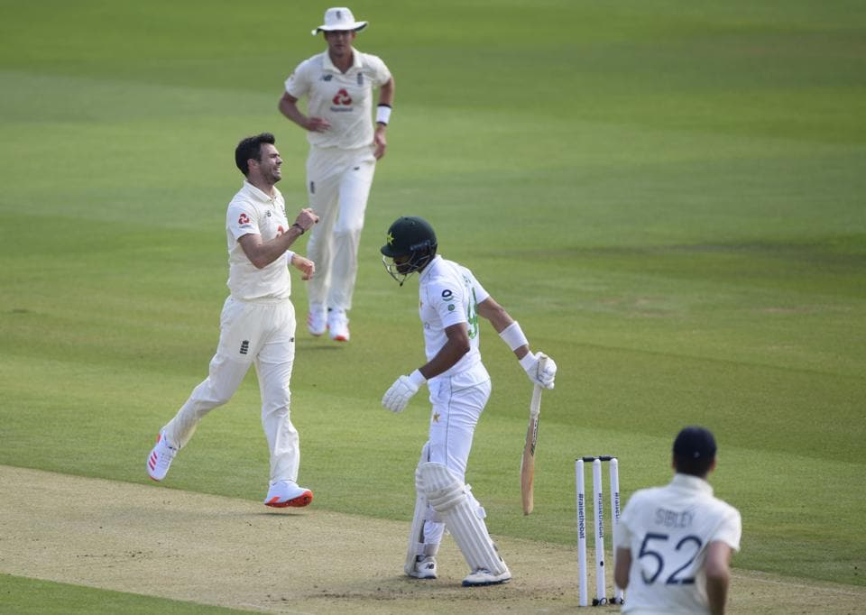 England's James Anderson, left, celebrates the dismissal of Pakistan's Shan Masood, second right, during the first day of the second cricket Test match between England and Pakistan, at the Ageas Bowl in Southampton, England, Thursday, Aug. 13, 2020. (Stu Forster/Pool via AP) (AP)