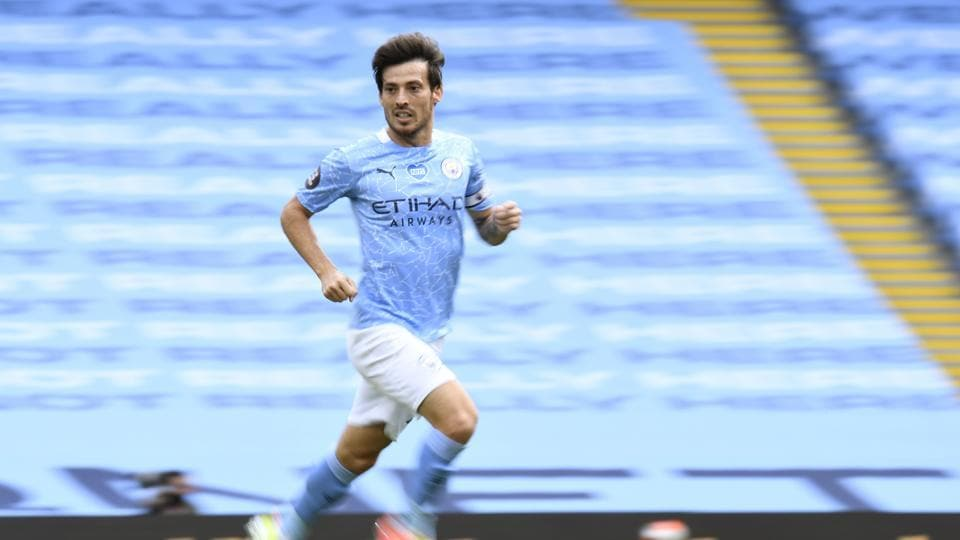 David Silva runs during the English Premier League soccer match between Manchester City and Norwich City at the Etihad Stadium in Manchester, England.