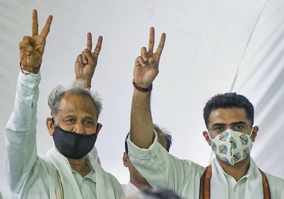 Rajasthan chief minister Ashok Gehlot along with senior Congress leader Sachin Pilot flashes victory signs during the party MLAs meeting, at CM residence in Jaipur on Thursday.