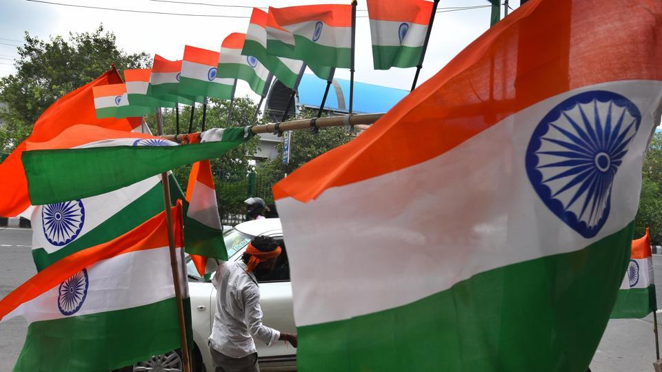 New Delhi, India - Aug. 12, 2020: A vendor selling the Indian tricolour ahead of Independence Day celebrations, near Akshardham Temple, in New Delhi, India.